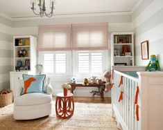 Love the striped walls and natural rug.  Originally saw this room via YHL's Babycenter post on nursery ideas.