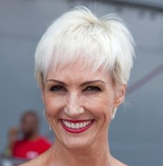 Bangs are great for mature women because they hide forehead wrinkles and bring the focus to the eyes; short hair like Amra-Faye Wright's -- which is a cute white pixie -- work well with all types of bangs. More short hair styles: Short Hair Over 40 Photos Short Hair Over 50 Photos Top 10 Must-Knows...