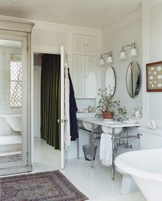 Vintage rug and double sinks—perfect.