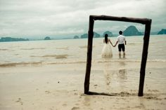 beach wedding, Lumiere Photographie. I don't think I could do that to my dress though....