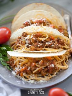 Spaghetti Tacos. Looks fun and look for Laura's Lean Ground beef to keep it healthy1