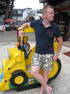 """My brother in law looking very happy that his engineering skills from his time in the Royal Navy came in useful when this arcade kids ride broke!"""