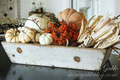 Fall planter box with pumpkins and such