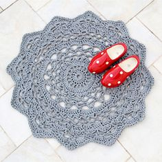 Crocheted doily rug.