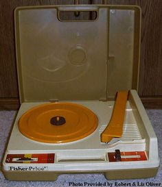 Fisher Price record player. ~I remember having something like this!!! So fun.