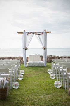 The scenic Hawaiian seascape was the perfect backdrop for this oceanside ceremony. Beautiful and elegant! {Rachel Robertson Photography}