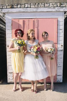 Tiered wedding dress and pastel bridesmaid dresses. Photography by www.greenphotographic.co.uk.