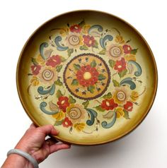 Rosemaling - a traditional Norwegian painting technique. Each region of Norway has its own variation. Rosemaling can be used to decorate anything from tableware, to trinket boxes, to furnishings, etc.