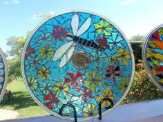 Hanging idea! by Poppins Mosaics and Crafts, via Flickr  -using old microwave plate