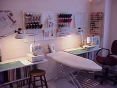 For me, this could be cutting on the left, sewing on the right, and ironing board in the middle. At the source, lots of good instructions for organizing your sewing area.