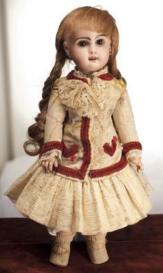 Jumeau bebe doll with open mouth. Not original dress, but antique fabric. Original socks.
