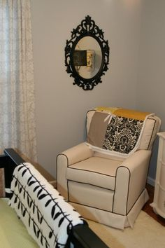 Yellow accents really pop in this black and white nursery.  #mirror #black #yellow #nursery