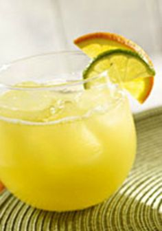 """Triple-Citrus """"Caipirinha"""" Cooler — Here's a family-friendly take on Brazil's national cocktail. The drink recipe gets its triple-citrus creds from lime juice, OJ and lemon-lime seltzer."""