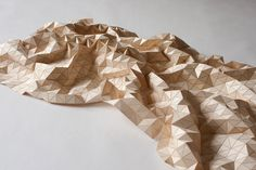 WOODEN TEXTILES: laser-cut wood tiles affixed to fabric. hard and soft.