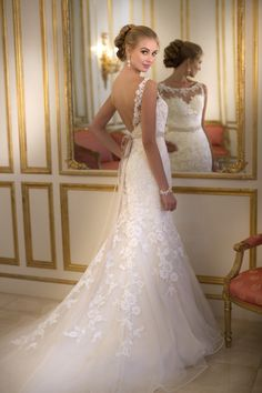 Beautiful floral lace wedding dress with satin bow.