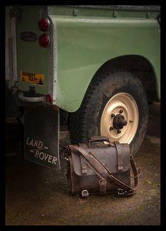 A man's bag among bags.