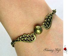 Harry potter Golden Snitch Bracelet with wings harri potter, snitch bracelet, style, bracelets, potter golden, golden snitch, harry potter, jewelri, thing