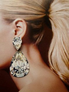 Big chandelier earrings - if only I had someplace to wear earrings like these!