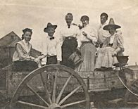 Harry Truman and members of his family in a farm wagon at Grandview, Missouri.