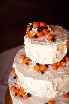 Citrus and berry wedding cake