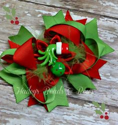 Dr. Seuss Grinch Inspired Hair Bow with Layers and Spikes on Etsy, $7.25