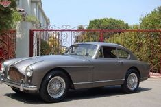 Vintage Aston Martin. I don't know dick about cars. What I do know? I would look good in this.