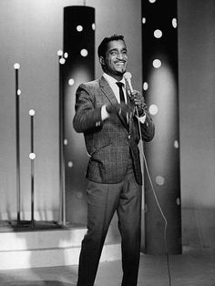 Sammy Davis Jr. performing and singing his heart out = world class entertainer.