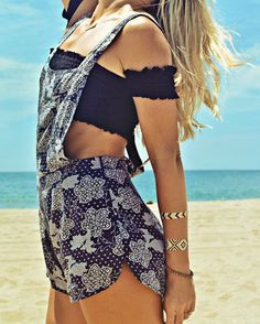 Overalls, crop top, and beach bling.