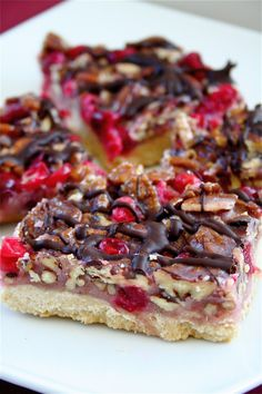Cranberry Turtle Bars (fresh cranberries and pecans are key ingredients).... topped with bittersweet chocolate!