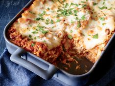 This simple lasagna is perfect for when you're short on time, but craving a comforting meal. Ready in just over an hour, it requires only 50 minutes of cooking in the oven. Extra-lean ground beef (which sometimes cooks up dry) works well here because it's combined with marinara to keep it moist. For a quick and easy variation, feel free to use 9 whole lasagna noodles instead of 6 broken noodles, using 3 noodles per layer. You also can sub fresh basil leaves for the parsley sprinkled on at the en
