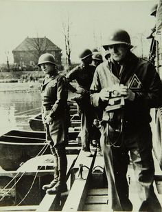 General Patton inspecting a pontoon bridge during the US advance past D-Day. Note the army photographer in the foreground.