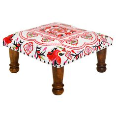 An embroidered ottoman is the perfect way to introduce a pop of color into a room. | $177