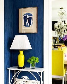Entry Hall With Blue Wallpaper and Yellow Lamp