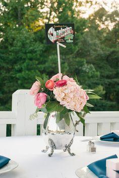 We love the hometown flair in this hydrangea and ranunculus #centerpiece I Riverland Studios I http://www.weddingwire.com/wedding-photos/real-weddings/blue-and-pink-plantation-wedding/i/5b77527c35327c6a-93aa056b6ac38d99/041146bea1b42b49