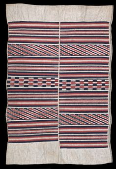 """Ijebu Yoruba """"aso olona"""", title cloth for Ogboni/Oshugbo society, late C19th or early C20th, Hand spun white and indigo cotton, imported red cotton. Unusually minimal design, Private collection, London."""