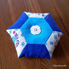 An adorable 8-hexie pin cushion for the 12 Hexies (or Less) Blog Hop, from Jessica at Life Under Quilts