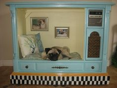Old TV repurposed into a dog bed, so cute for a small dog