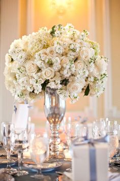 Centerpieces White roses tall round centerpiece