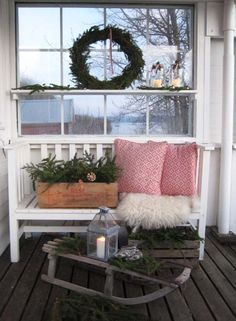 Prim Winter Front Porch...love the old sled for a table.