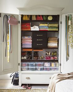 Add shelves, shelf dividers and bins to use every square inch of an old TV armoire