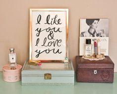 i like you  i love you print in a gold frame.