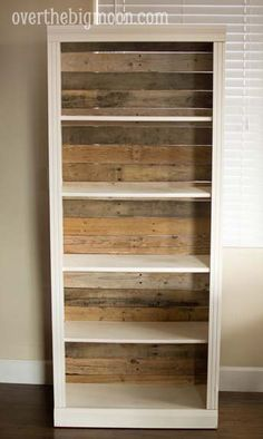 Take the cheap backing off of a bookshelf and add pallet boards.  Beautiful! This could also apply to adding beadboard or painted/wallpapered backing