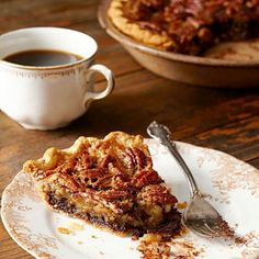 Black-Bottom Pecan Pie: This pecan pie is filled with a sweet, chocolatey center.  More holiday pie recipes: http://www.midwestliving.com/food/desserts/favorite-holiday-pies/page/10/0