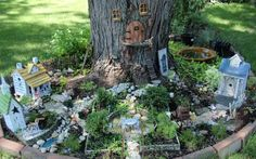 Fairy garden at the base of a tree.