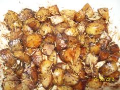 Made tonight.  My version of Balsamic Roasted Potatoes.  They were good.  I couldn't see where it said to cover them, but I did later and they cooked faster after that.