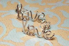 Love Earrings Sterling Silver on etsy. I want these!
