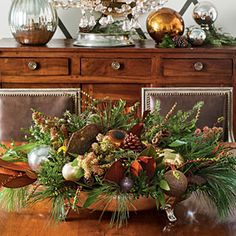 Gorgeous centerpiece with vintage ornaments & clippings from the garden!