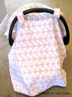 @Brittney Anderson Garza you need to make this for @Brooke Baird (Rane) Besanceney & then remember it for your future reference DIY car seat canopy. Baby shower gift idea.