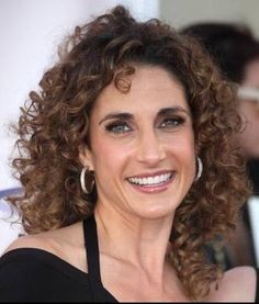 Love her naturally curly hair!