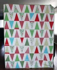 Nothing will make Christmas feel as merry as a Christmas quilt filled with little elf hats. @Andy has a paper piecing pattern you can use to make these cute quilt blocks before the holidays.